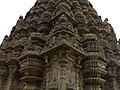 Turret and pilaster work where the shrine wall meets the tower in Amritesvara temple at Annigeri.jpg