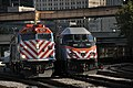 Two Metra Commuter Trains Meet at the Milwaukee Road Lake Street Tower (4925226353).jpg