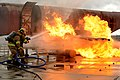 U.S. Air Force firefighters suppress an engine and fuel fire during a live-fire training exercise at Spangdahlem Air Base, Germany, Jan. 8, 2014 140108-F-OP138-212.jpg
