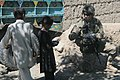U.S. Army Spc. Brittany Kabe, right, with a female engagement team, gives candy to children in Paktia province, Afghanistan, May 29, 2013 130529-A-CW939-045.jpg