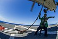 U.S. Navy Logistics Specialist Seaman Nick Fleming, foreground, and Logistics Specialist 3rd Class Kyle Shy run to safety after attaching cargo legs to an MH-60S Seahawk helicopter assigned to Helicopter Sea 131115-N-ZS026-268.jpg