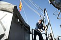 U.S. Navy Quartermaster 3rd Class Anthony Diberardino raises a flag during a replenishment at sea aboard the guided missile cruiser USS Gettysburg (CG 64) in the Gulf of Oman Jan. 1, 2014 140101-N-PL185-161.jpg