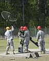 U.S. Soldiers train to assemble and erect an antenna at Fort Gordon, Ga., April 17, 2009 090417-A-NF756-012.jpg