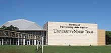 "Large building with the words ""Murchison Performing Arts Center University of North Texas"" displayed in large letters."