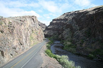 U.S. Route 26 - US 26 at the entrance to Picture Gorge in Eastern Oregon. The John Day River is to the right of the roadway.