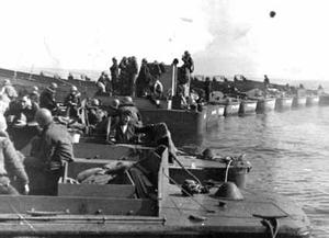 USS-Audubon Landing-craft-fantail-maneuvers Feb-1945.png
