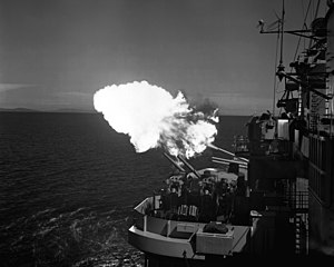 USS Saint Paul (CA-73) - Saint Paul firing at Korean coastal batteries in 1953.