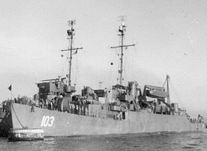 USS Tollberg (APD-103) at anchor, in December 1945