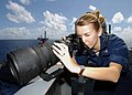 US Navy 030122-N-5786V-501 Sabrina Day from Beaufort, S.C., uses a 400mm fixed telephoto lens to photograph daily activity aboard the aircraft carrier.jpg
