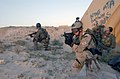 US Navy 030315-N-5362A-005 Naval Special Warfare team members conduct a training operation from a forward operating location.jpg