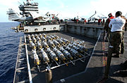US Navy 030321-N-3235P-510 On the flight deck aboard the aircraft carrier USS Harry S. Truman (CVN-75), 2000 lbs GBU-31 Joint Direct Attack Munitions (JDAM) are transported to the flight deck