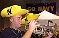 US Navy 031229-N-9693M-002 U.S. Naval Academy (U.S.N.A.) Midshipmen 4th Class Jason Pallota, from Daytona, Fla., plays the trumpet during the EV1.Net Rodeo Pep Rally in Reliant Arena.jpg
