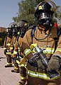 US Navy 040303-N-8955M-007 Firefighters prepare to douse simulated flames in a burning car during Exercise Desert Sailor 2004 on board Naval Support Activity Bahrain.jpg