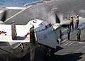US Navy 040907-N-9228K-051 Aviation Boatswain's Mates direct a C-2A Greyhound onto one of four steam powered catapults aboard the Nimitz-class aircraft carrier USS Abraham Lincoln (CVN 72).jpg