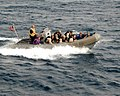 US Navy 050503-N-9563N-004 Members of USS Mustin's (DDG 89) Visit, Board, Search, and Seizure (VBSS) Team conduct a training exercise in a rigid hull inflatable boat.jpg