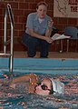 US Navy 050804-N-8544C-079 Photographer's Mate 3rd Class Johanna English monitors Photographer's Mate 2nd Class Andrea Decanini as she practices the swimming portion of the physical fitness test.jpg