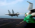 US Navy 051207-N-9362D-005 Photographer's Mate Airman Nathan Laird of Ocean City, Md., photographs an F-14D Tomcat, assigned to the Blacklions of Fighter Squadron Two One Three (VF-213), as it launches off the flight deck.jpg