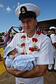 US Navy 060525-N-9643K-008 Senior Chief Woodrow Purkey meets his 7-day-old son for the first time, following the return of the guided-missile destroyer USS Chung-Hoon (DDG 93) to Pearl Harbor after a four-month maiden deploymen.jpg