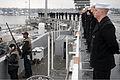 US Navy 070116-N-0684R-147 Security personnel man a .50-caliber machine gun while Sailors man the rails as the USS John C. Stennis (CVN 74) departs Naval Base Kitsap Bremerton for a scheduled deployment.jpg
