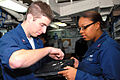 US Navy 070419-N-9689V-002 Sailors assigned to the amphibious assaults ship USS Boxer (LHD 4), repair a laptop computer in the ship's data systems repair shop.jpg