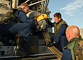 US Navy 070623-N-5822P-058 Fire Controlman 1st Class Robert S. Valiquette, right, supervises as Fire Controlman 3rd Class Authur M. Andreasen, left, and Fire Controlman 3rd Class Jeffrey S. Campbell load ammunition into the for.jpg