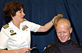 US Navy 070627-N-1134L-002 Commandant of Midshipmen, Capt. Margaret Klein gives a haircut to a plebe, or freshman, on the U.S. Naval Academy Class of 2011 on Induction Day.jpg