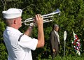 US Navy 070715-N-6387D-004 Musician 3rd Class Shelby G. Tucci, with Navy Band Southeast, plays taps at the memorial service held along U.S. Route 17 at the site where Lt. Cmdr. James Warmowski was fatally struck in 2002.jpg