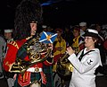US Navy 070907-N-5174T-005 Musician 3rd Class Helena Giammarco, a Pacific Fleet band member, plays the French horn backstage with a friend from the Royal Regiment of Scotland following the second night of performances at the Ku.jpg