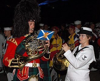 Band of the Royal Regiment of Scotland - Image: US Navy 070907 N 5174T 005 Musician 3rd Class Helena Giammarco, a Pacific Fleet band member, plays the French horn backstage with a friend from the Royal Regiment of Scotland following the second night of performances at the Ku