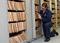 US Navy 080724-N-5384B-197 Personnel Specialist 1st Class John Hawkinson, assigned to the Administrative Department aboard the Nimitz-class aircraft carrier USS Abraham Lincoln (CVN 72) searches for a personnel record.jpg