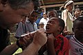 US Navy 080818-N-9620B-009 U.S. Public Health Service Lt. Cmdr. Gary Brunette cleans and applies fluoride to the teeth of a young Nicaraguan boy so the enamel of his teeth can strengthen over time.jpg