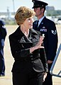 US Navy 080916-N-8053S-112 First Lady Laura Bush waves at the crowd gathered at Naval Air Station Joint Reserve Base Fort Worth, Texas.jpg