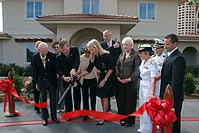 US Navy 081003-N-2688M-095 Guests cut the ribbon at Naval Medical Center San Diego for the grand opening of the second Fisher House.jpg