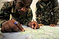 US Navy 081009-N-0411D-001 Construction Electrician Ricardo Barrow practices his land navigation skills during a Navy Expeditionary Combat Skills School training exercise.jpg