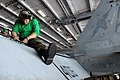 US Navy 081104-N-1635S-001 Aviation Structural Mechanic 2nd Class Andrew Miller, from Houston, connects a new wing section on an F-A-18C Hornet assigned to the.jpg