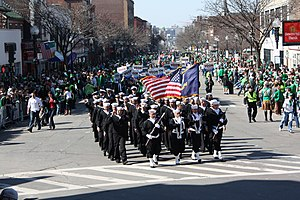 US Navy 090315-N-8110K-011 A crowd along a parade route in South Boston cheers Sailors from the guided-missile frigate USS Taylor (FFG 50) as they march in the 108th Annual St. Patrick's Day Parade