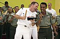 US Navy 090629-N-1722M-162 Musician 1st Class Danny McGowan, assigned to the U.S. 7th Fleet rock band, Orient Express, sings with Malaysian Army Cpl. Nor Azlan during a performance with the Malaysian Armed Forces KOMBO D' Tiger.jpg