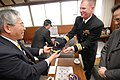 US Navy 100301-N-3283P-064 mdr. Errin P. Armstrong, commanding officer of the guided-missile destroyer USS Pinckney (DDG 91), presents a command ball cap to Seiichi Takenaka, Vice Mayor of Komatsushima, Japan.jpg