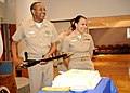 US Navy 100331-N-7214P-022 Senior Chief Hospital Corpsman Carl N. White, left, and Chief Hospital Corpsman Estrellita D. Edmond the oldest and youngest chiefs at Naval Medical Center San Diego, prepare to cut the Chief's Birthd.jpg