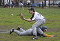 US Navy 100509-N-9815L-061 Lt. j.g. Curtis Sanders slides safely into first base as Sailors from the guided-missile frigate USS Kauffman (FFG 59) play baseball against the St. Petersburg North Stars, a Russian semi-pro baseball.jpg