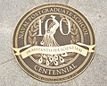 US Navy 100609-N-1993R-003 The four foot bronze cover plate bearing the centennial peacock logo that covers the NPS Time Capsule in Spruance Plaza at the Naval Postgraduate School.jpg