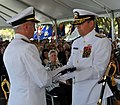 US Navy 100806-N-6306H-003 Rear Adm. Joseph Rixey presents the American flag to Rear Adm. Michael Bachmann during the Space and Naval Warfare Systems Command (SPAWAR) change of command ceremony.jpg