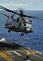 US Navy 100914-N-0120A-273 A CH-53E Sea Stallion helicopter assigned to Marine Medium Helicopter Squadron (HMM) 262, takes off from the forward-dep.jpg