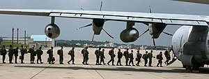 Operation Tomodachi - Marines move from Okinawa aboard a KC-130