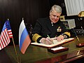 US Navy 110415-N-ZB612-479 Chief of Naval Operations (CNO) Adm. Gary Roughead signs the guest book of the Russian Federation Navy nuclear-powered c.jpg