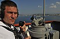 US Navy 110703-N-AG285-126 Quartermaster 3rd Class Christopher Koch uses a sound-powered telephone aboard USS Whidbey Island (LSD 41).jpg