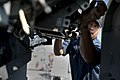 US Navy 111231-N-KS651-444 Gunners Mate 1st Class Johnny Salinas performs maintenance on a Mk 38 MOD 2 25mm machine gun system aboard the amphibiou.jpg