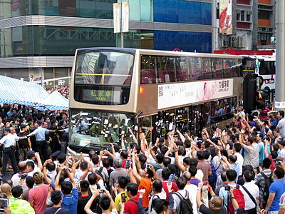 Umbrella Revolution Mong Kok KMB Bus leave 20141003.jpg