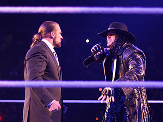 WrestleMania XXVIII - Chief Operating Officer Triple H being taunted by The Undertaker ahead of their second consecutive WrestleMania match