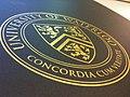University of Waterloo coat of arms, gold on black.jpg